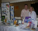 Lisa and Husband, Joel at Display Table at Event
