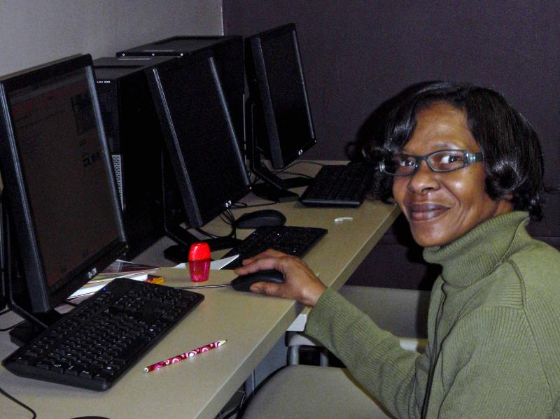 A student works on her GED in Baldwin's computer lab