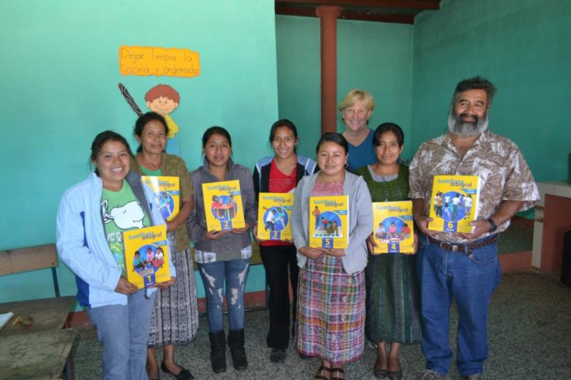 Happy teachers receive new text books