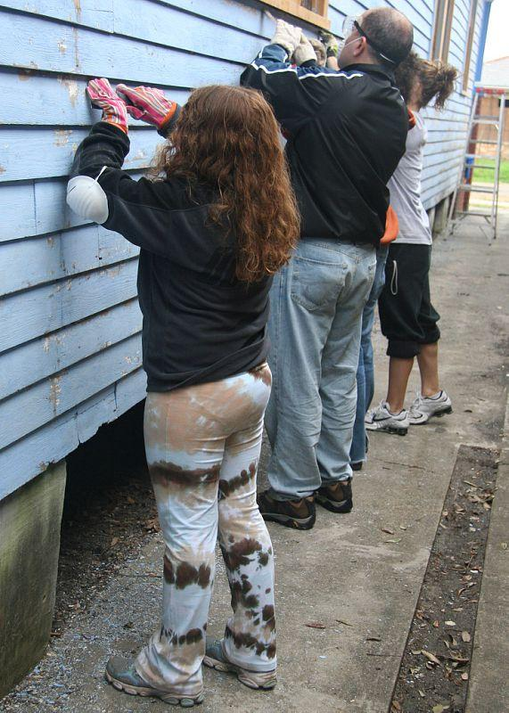 Volunteers painting a New Orleans home