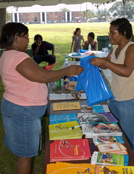 Parents and children get school supplies and helpful information at a back-to-school event.