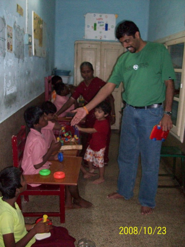 Suresh interacting with some of the mentally challenged kids at Nesam