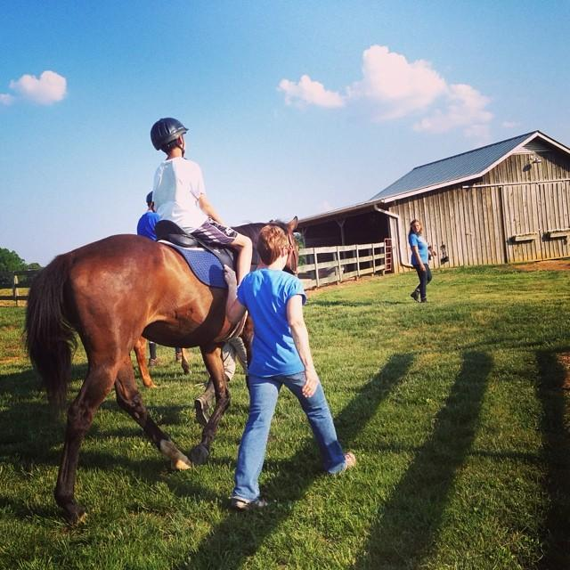 Clients enjoy riding in a variety of settings, including indoor and outdoor arenas, a sensory trail, and around the farm