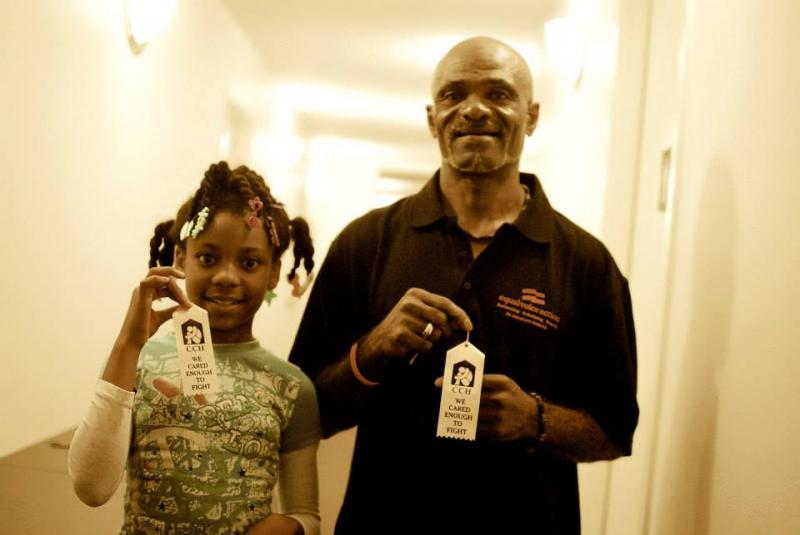 Charles Jenkins and his daughter holding up their