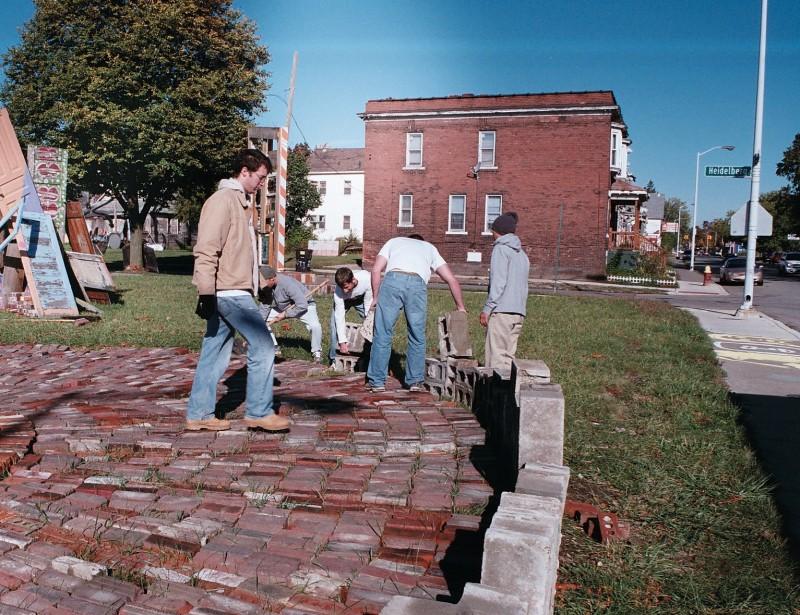 Volunteers work on the Community Sundial on Heidelberg and Mt. Elliott.