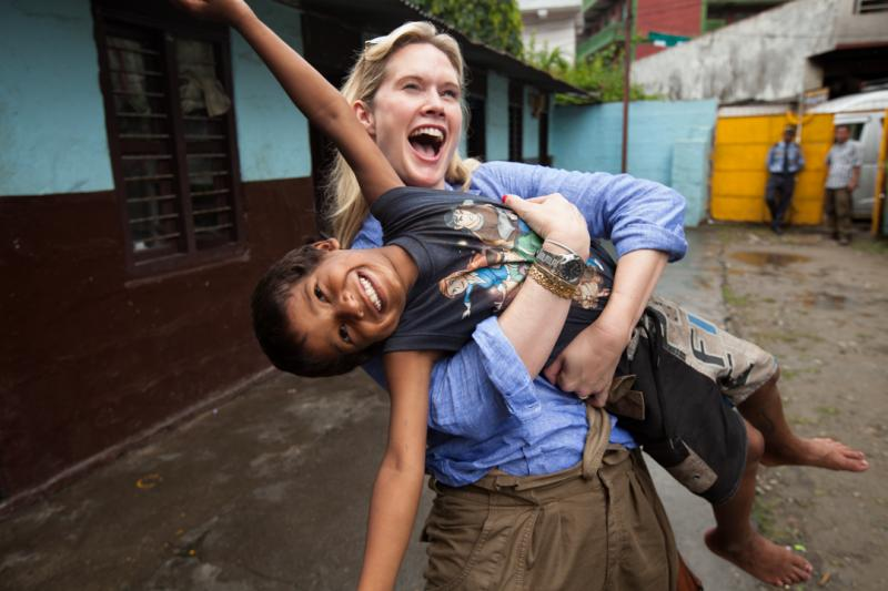 Celebrity Ambassador Stephanie March in Nepal with a children served by a Honoree's program