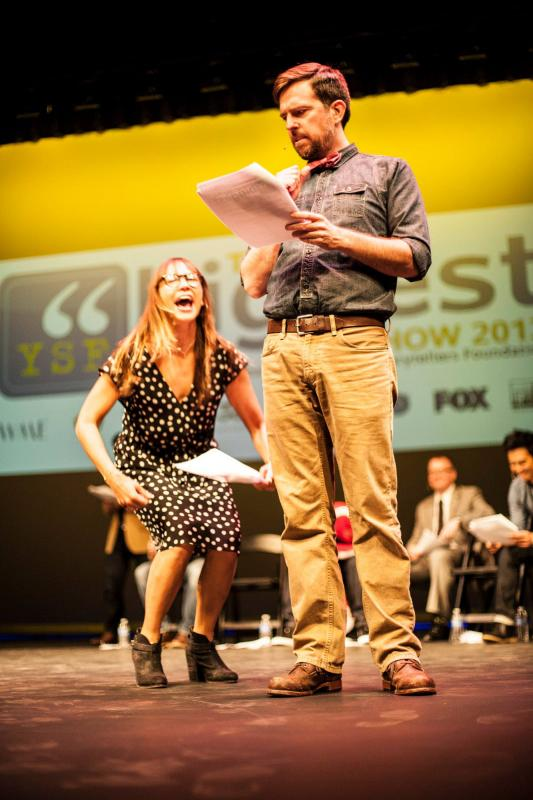 Ed Helms and Rashida Jones perform a student's story at the Biggest Show.
