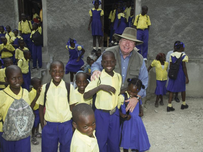Founder and director Bobby Burnette with Haitian school children. These children are sponsored by Love A Child partners. Just $24 a month pays for one child to receive a Christian education, uniforms, books, supplies, and a hot meal each day.