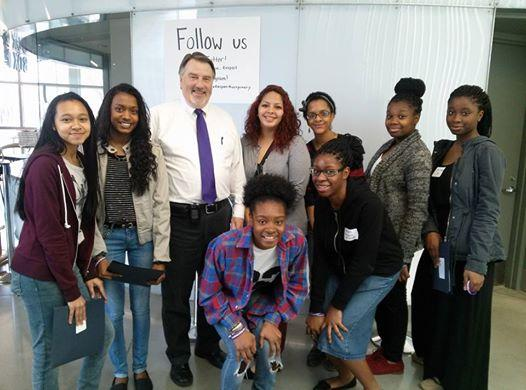 Community Bridges High School (CBHS) girls at a workforce development fair with board member, and vice president of Montgomery College.