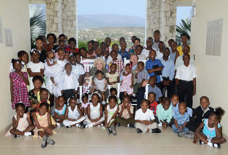 Bobby and Sherry Burnette with orphan children at the Love A Child Hope Center orphanage, located in Fond Parisien, Haiti.