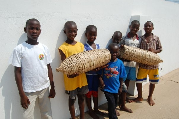 AEI students at Teshie Orphanage in Ghana holding fishing baskets they made