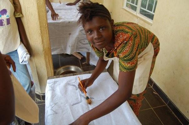 AEI Student learning to make batik fabric in Daru, Sierra Leone