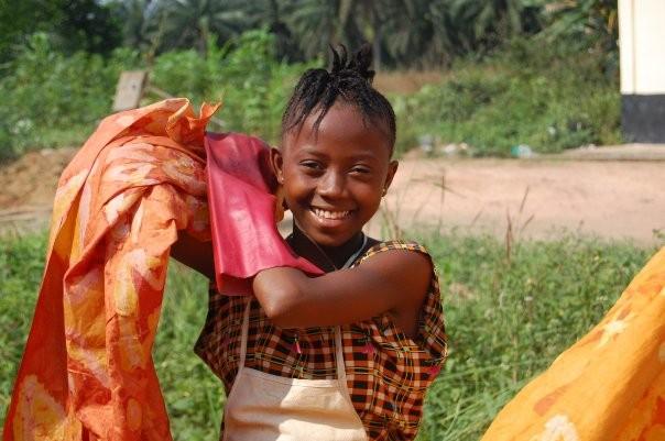 AEI student with batik fabric she made: Daru, Sierra Leone