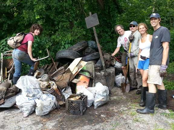 Some of our great volunteers with a pile of trash hauled out of the West Branch of the Housatonic River.