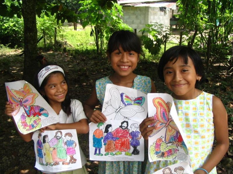 Showing off the beautiful coloring they did at a children's program in a small village near Palenque