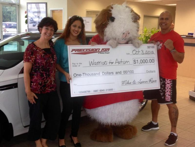Precision Kia Of Tampa Bay Awards Warriors For Autism With A Check!