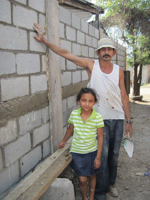 With a little help from our program, this family now has a wall to keep the rains out.