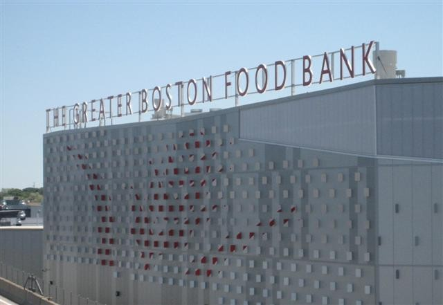 View of completed tabs showing letterings and wheat symbol on exterior facing I-93.