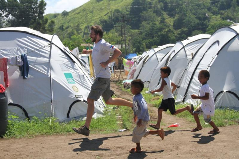 Project Director Chris takes a break to play with the kids living in tent city.