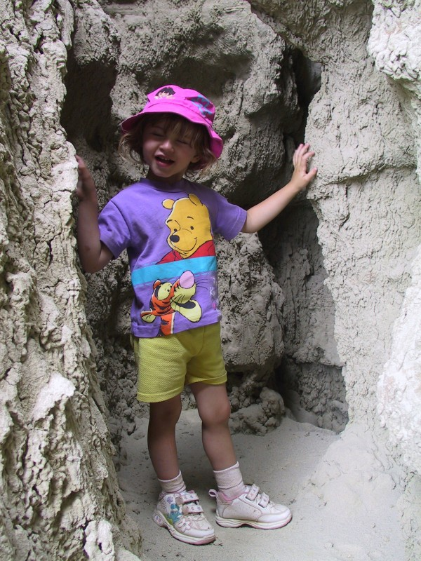 Child explores Adobe Town, photo by BCA.