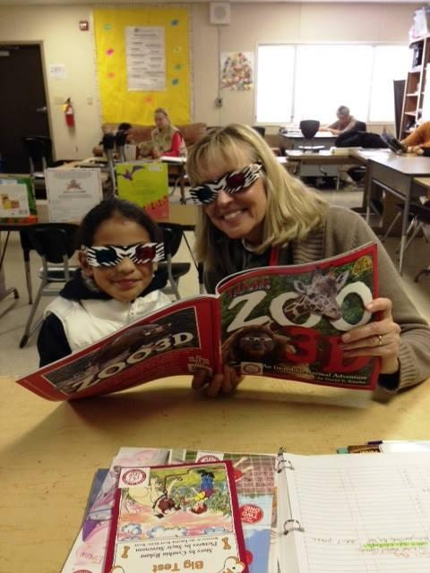 Volunteer Reader and student enjoying a book wuth 3D pictures