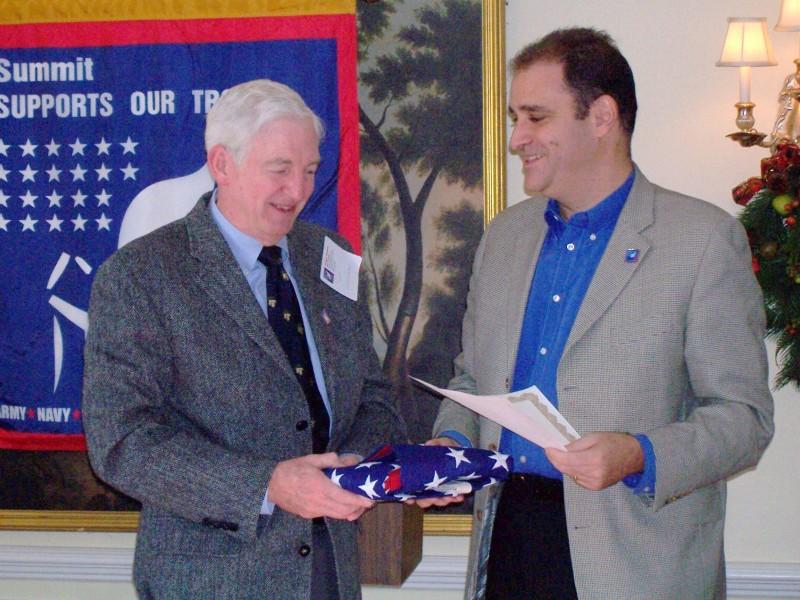 Family of Marine, Art Williams, received flag from Mayor Glatt
