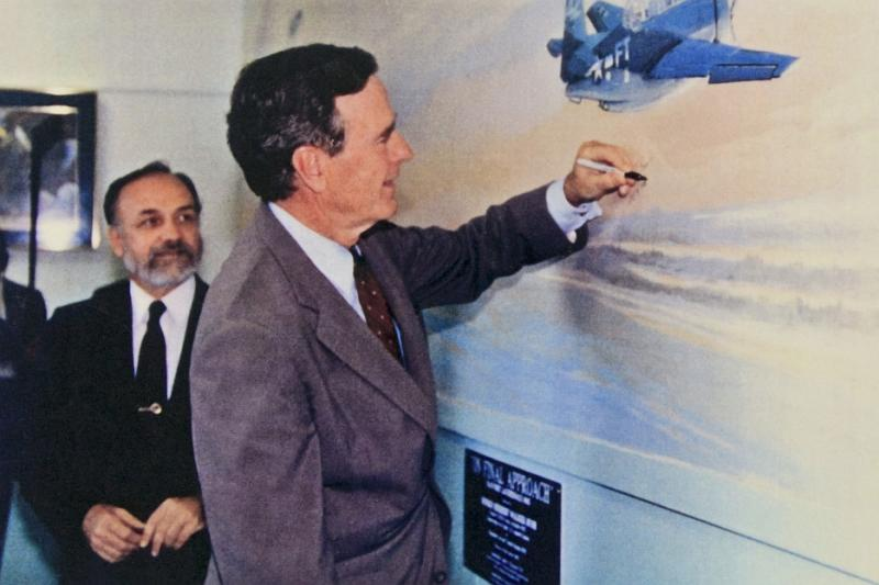 President George H.W. Bush signing of the mural.