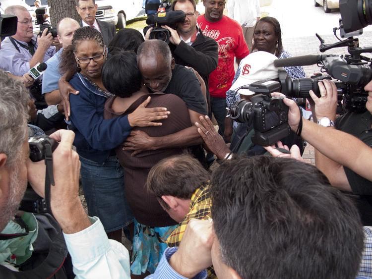 James Bain hugs his family. James was released after serving 35 years for a crime he did not commit.