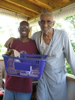A Meals on Wheels client and volunteer pause for a picture.
