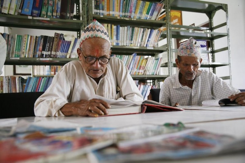 Men reading in a READ Nepal Library and Resource Center