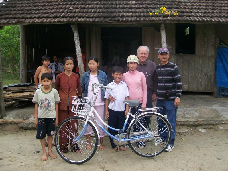 Young boy with family received bike to travel to school