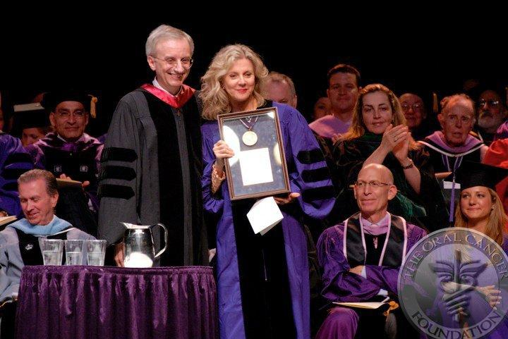 Actress Blythe Danner (Paltrow) receives the Kriser Medal for public service from NYU at Madison Square Gardens in NYC for her work with OCF in the oral cancer cause. On her right is Dr. Charles Bertolami, Dean of the College of Dentistry.