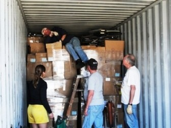 US volunteers loading donated medical supplies for distribution in Bolivia