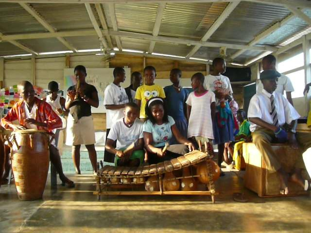 Orphans in a band playing African folk instruments - Art Camp Ghana
