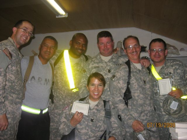 Chaplain in Afghanistan with soldiers and sailors