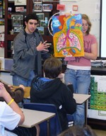 Teen volunteers lead a class discussion on the dangers of smoking