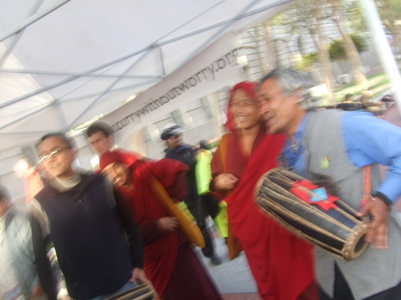 Founding members and visiting Bhutanese monks enjoy collective song.