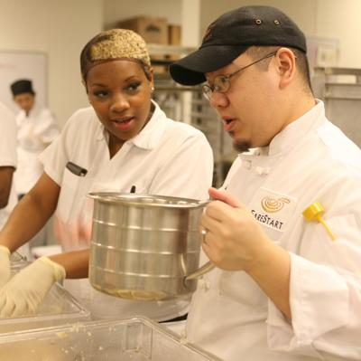 Chef Instructor and student in the FareStart kitchens