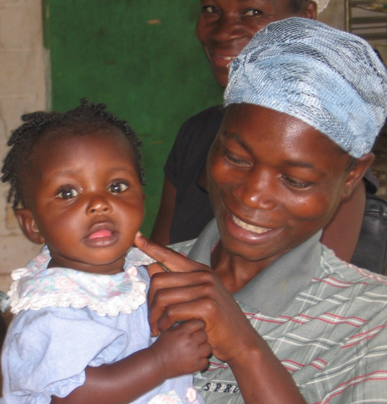 Patient plays with daughter at our clinic in Beaumont, Haiti
