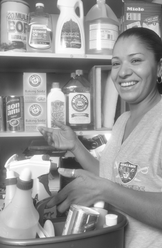 Claudia poses in front of some of the Eco Friendly Cleaning products she uses in her work.
