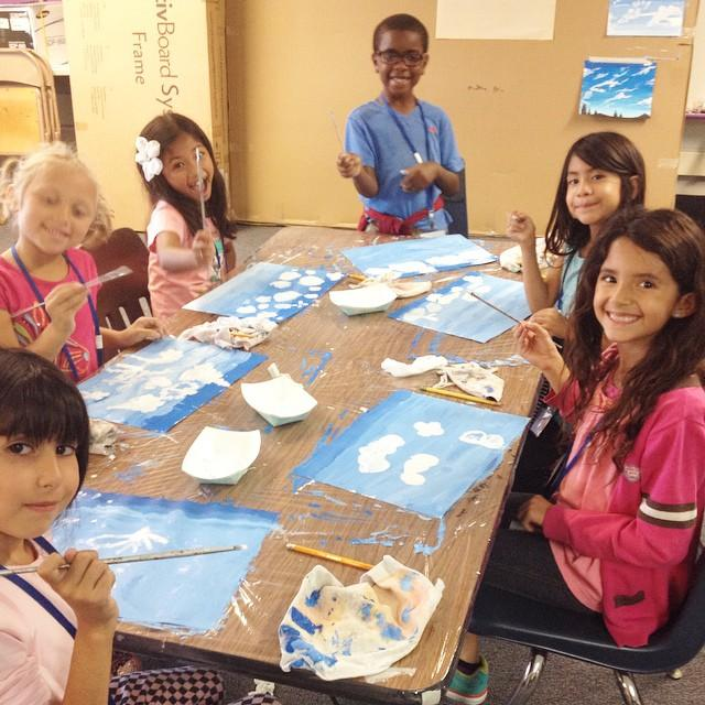 Students learn about clouds and them paint them using tints and shades.