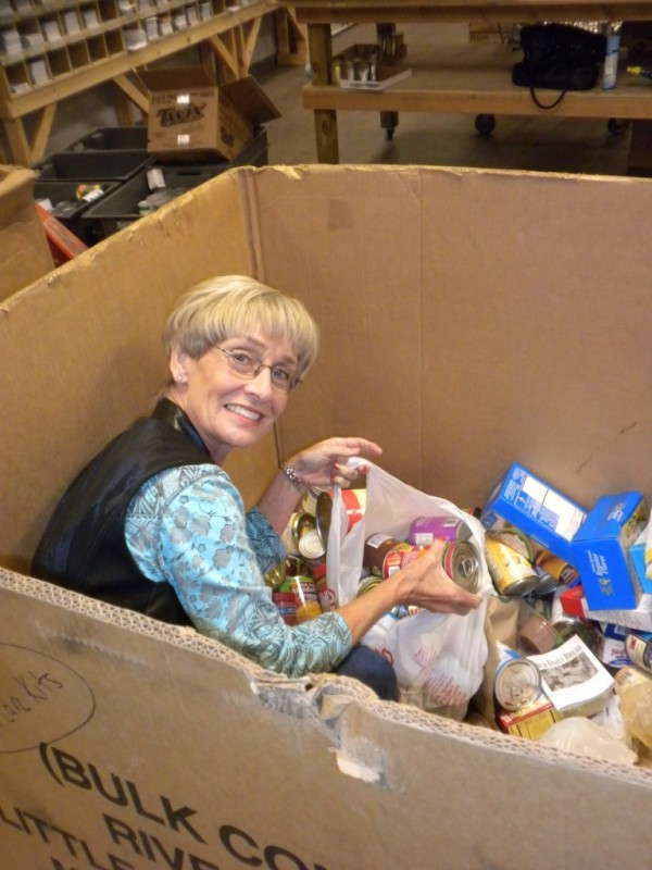Volunteers help sort donated food items.