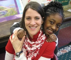 A student poses with her volunteer tutor at EECM's ExtraOrdinary Tutoring program.