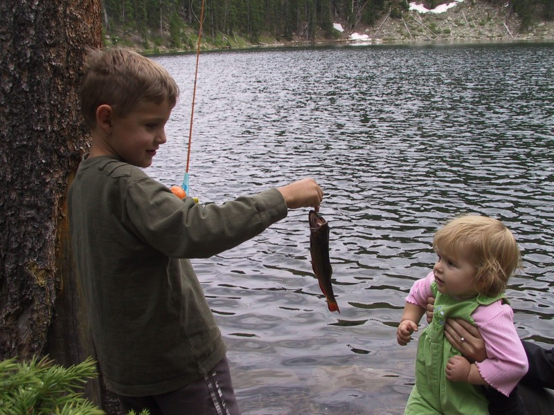 Boy displays his fish at Crater Lake, Rock Creek Proposed Wilderness, Medicine Bow National Forest.