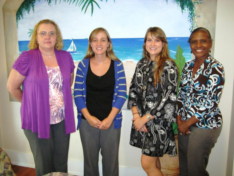 Volunteers Nancy and Maureen with Client Service Director Sarah and Executive Assistant Lindsey.
