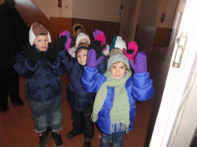 Kids were thrilled to receive gloves, scarves and hats!