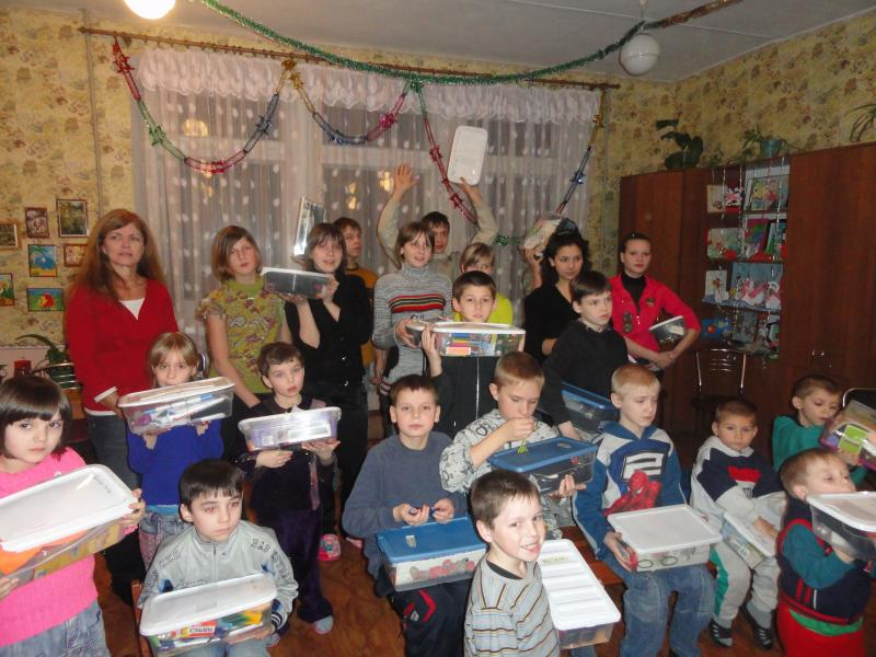 Kids at the local shelter receive Christmas boxes, 2011