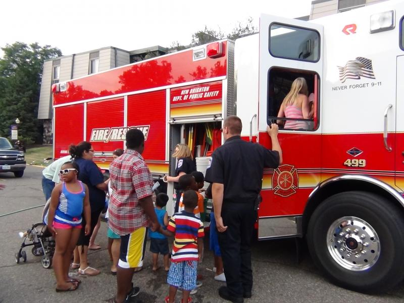Checking out the New Brighton Fire Truck at the 2014 National Night Out celebration at Garden View Apartments.