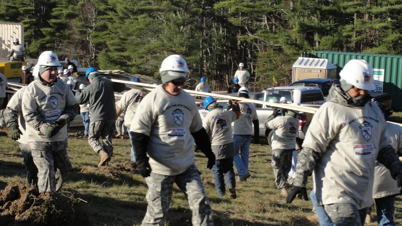 MA National Guard brought their Army of volunteers to help build this home