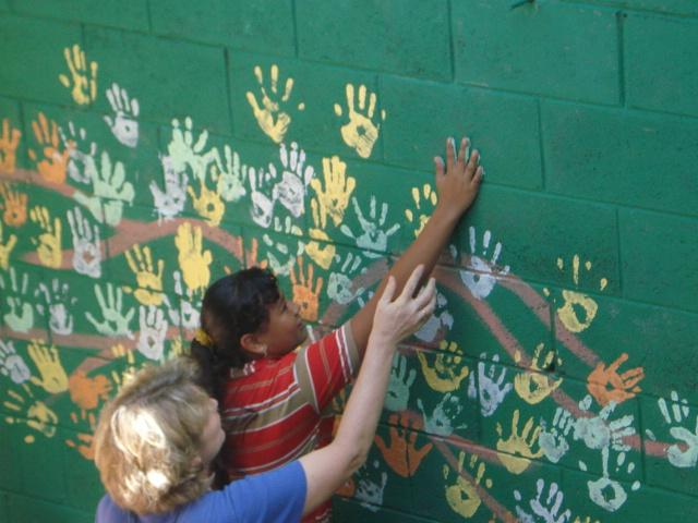 Our volunteers working with the children in El Salavdor. Our volunteers painted the school